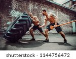 two muscular athletes training. ... | Shutterstock . vector #1144756472
