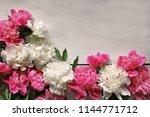 peonies on wooden background    Shutterstock . vector #1144771712