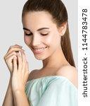 beautiful young smiling woman... | Shutterstock . vector #1144783478