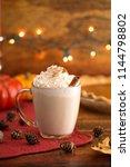 pumpkin pie spiced latte in a... | Shutterstock . vector #1144798802