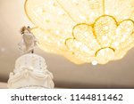 figurines of the bride and... | Shutterstock . vector #1144811462