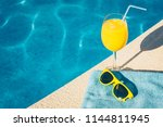 sunglasses and a glass of... | Shutterstock . vector #1144811945
