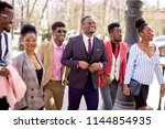 african tourists enjoying the... | Shutterstock . vector #1144854935