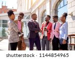 an afro ceo in stylish blue... | Shutterstock . vector #1144854965