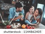 mom  dad and daughter are...   Shutterstock . vector #1144862405