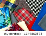 fabric of different kinds on... | Shutterstock . vector #1144863575