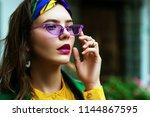 outdoor close up portrait of... | Shutterstock . vector #1144867595