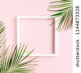 white frame and tropical palm... | Shutterstock . vector #1144873328