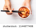 hand holding kimchi cabbage in... | Shutterstock . vector #1144877408