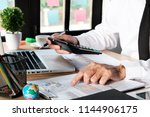businessman hand working with... | Shutterstock . vector #1144906175