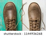 close up vintage leather shoes... | Shutterstock . vector #1144936268