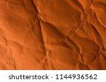 orange crinkle paper background. | Shutterstock . vector #1144936562