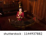 lao girl dressed in traditional ... | Shutterstock . vector #1144937882