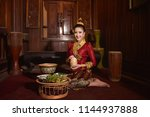 lao girl dressed in traditional ... | Shutterstock . vector #1144937888