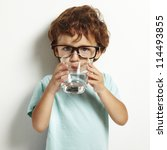 portrait of boy drinking glass... | Shutterstock . vector #114493855