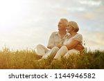 senior couple resting at summer ... | Shutterstock . vector #1144946582