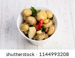 tasty salty pickled mushrooms... | Shutterstock . vector #1144993208