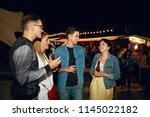 friends having fun on party in... | Shutterstock . vector #1145022182