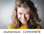 young woman smiling. | Shutterstock . vector #1145034878
