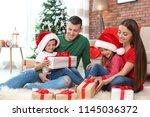 happy parents and children... | Shutterstock . vector #1145036372