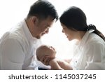 happy smiling family three... | Shutterstock . vector #1145037245