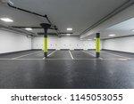 empty car parking  new... | Shutterstock . vector #1145053055