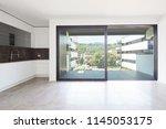 interiors of modern apartment ... | Shutterstock . vector #1145053175