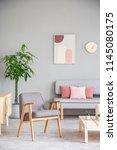grey armchair standing in... | Shutterstock . vector #1145080175