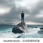 Businessman Standing On Rock In ...