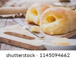 home made bread and butter | Shutterstock . vector #1145094662