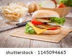 hamburger with  ingredients on... | Shutterstock . vector #1145094665