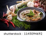sour soup with prawn and... | Shutterstock . vector #1145094692