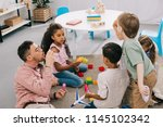 teacher with soap bubbles and... | Shutterstock . vector #1145102342