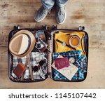 preparing travel suitcase high... | Shutterstock . vector #1145107442