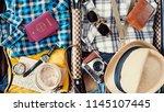 preparing travel suitcase high...   Shutterstock . vector #1145107445