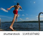 young man jumping into water.... | Shutterstock . vector #1145107682