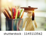 Small photo of Back to School Concept, People Sign wood with Graduation celebrating cap blur pencil box, show alternative studying. Graduate or Education knowledge learning study abroad international Ideas.