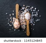 two wooden spoons with pink... | Shutterstock . vector #1145124845