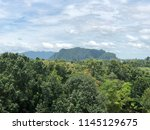 big forest and high mountain... | Shutterstock . vector #1145129675