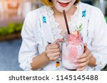 refreshing with glass of red... | Shutterstock . vector #1145145488