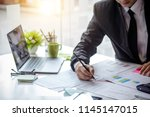 businessman working on the... | Shutterstock . vector #1145147015