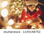 merry christmas. girl wrapping... | Shutterstock . vector #1145148752