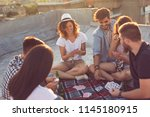 group of young people sitting... | Shutterstock . vector #1145180915
