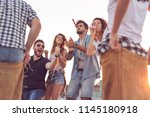 group of young people having... | Shutterstock . vector #1145180918