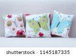 cushions with little butterflies | Shutterstock . vector #1145187335