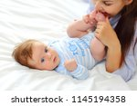 family portrait of mom and baby ... | Shutterstock . vector #1145194358