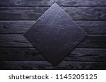 slate over old wooden black... | Shutterstock . vector #1145205125