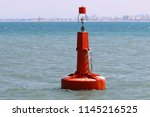 lighthouse on the beach | Shutterstock . vector #1145216525