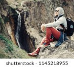 traveler young man sitting on... | Shutterstock . vector #1145218955