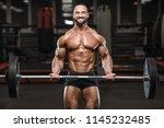 brutal strong bodybuilder... | Shutterstock . vector #1145232485